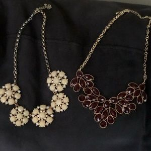 Two statement piece necklaces.